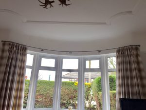 Wrought iron curved bay window curtain pole